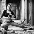 Stock Photo: Young woman in a ruined building