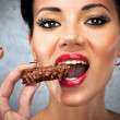 Young woman eating sweet — Stock Photo #3071803
