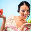 Stock Photo: Young womwith two apples