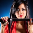 Young japanese womwith samurai sword — Stock Photo #3071862