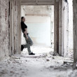 Stock Photo: Young woman in ruined building