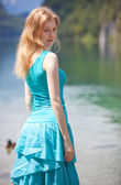 Young blond woman in blue dress — Stock Photo