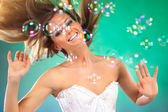 Young woman with soap bubbles — Stock Photo