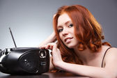 Young woman listening radio — Stock Photo