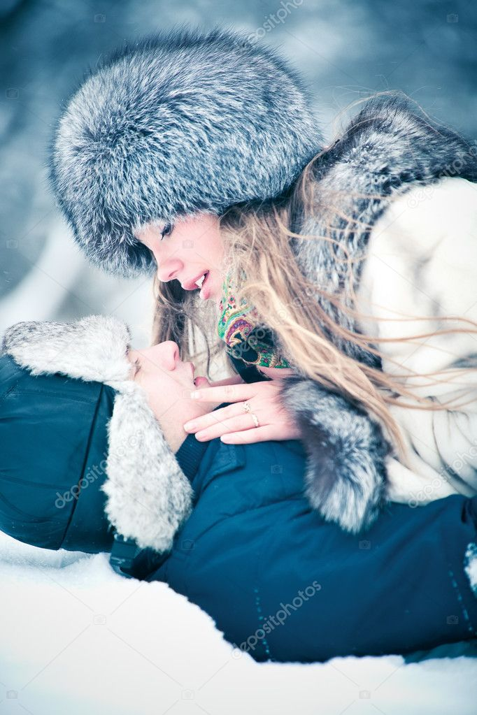 Young couple outdoors winter portrait. Soft blue tint. — Stock Photo #3071358