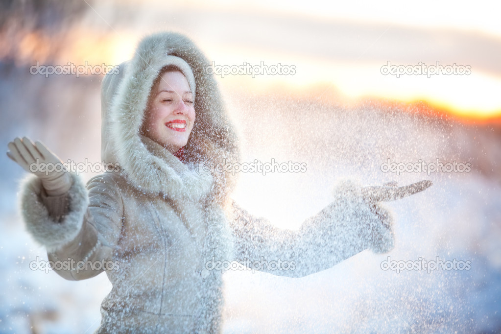 Young happy woman throwing up snow. — Stock Photo #3071485