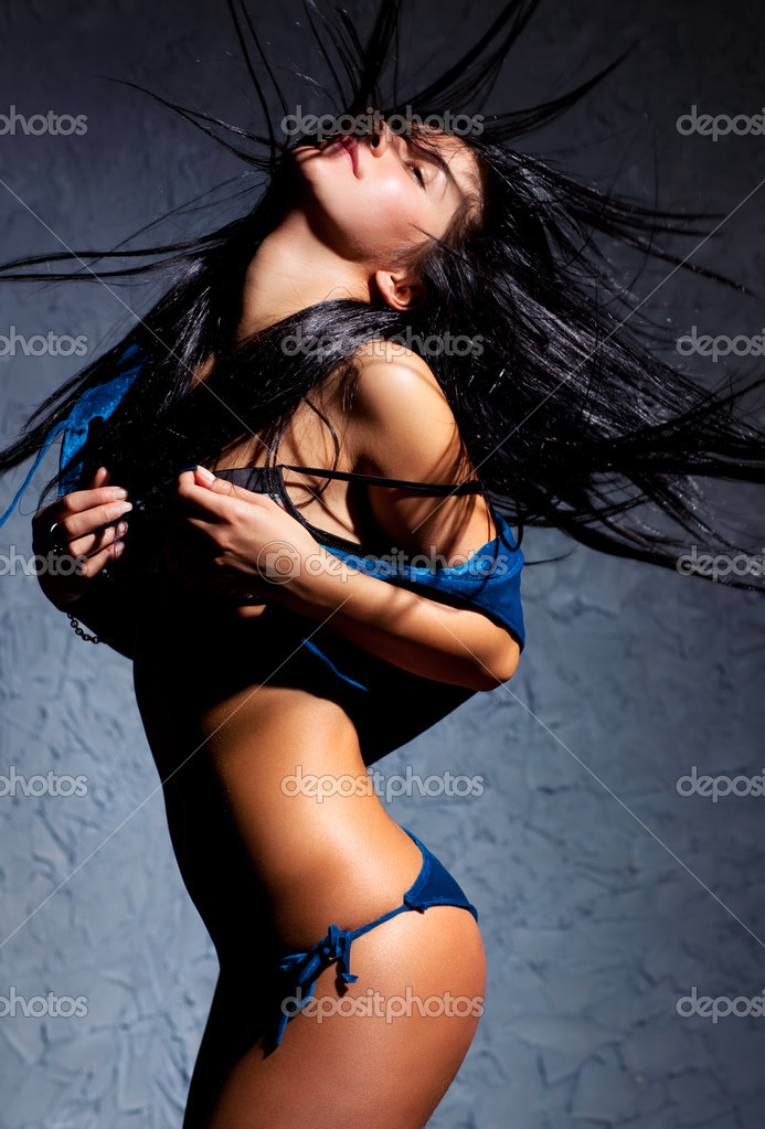 Young dancing woman. Contrast shadows effect. — Stock Photo #3071497
