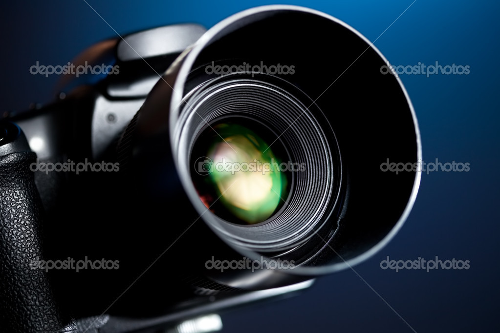 Professional DSLR camera on blue background. — Stock Photo #3071537