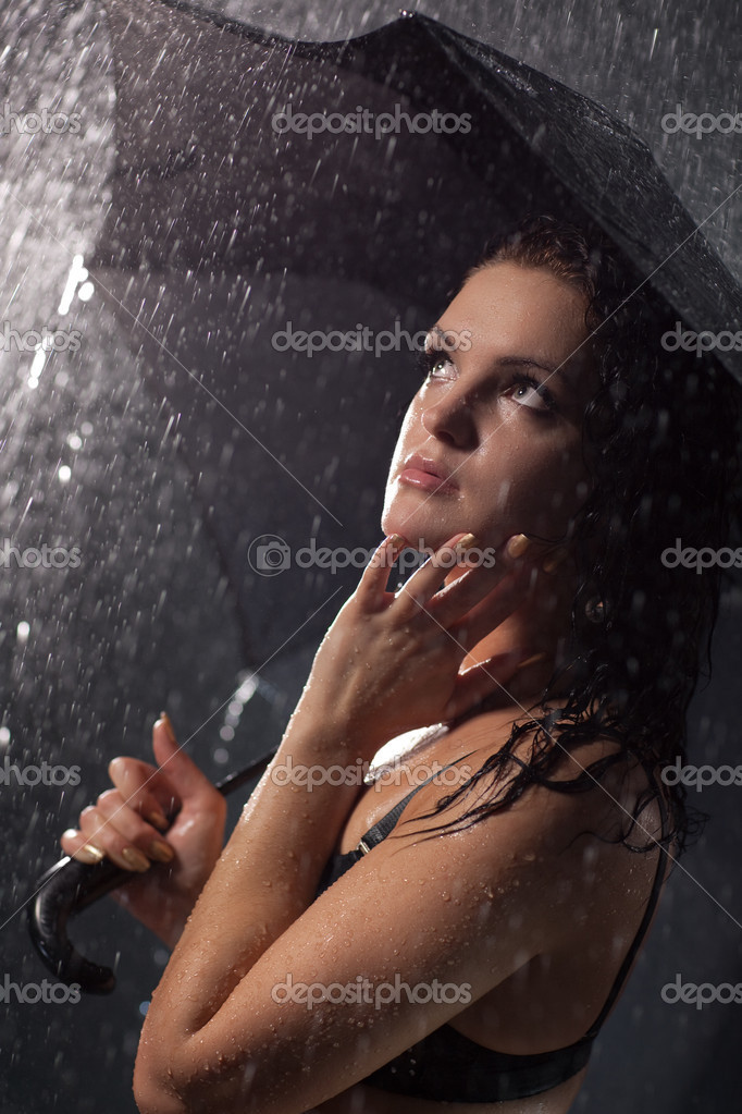 Young woman with umbrella under the rain. Water studio photo.  Stock Photo #3071733