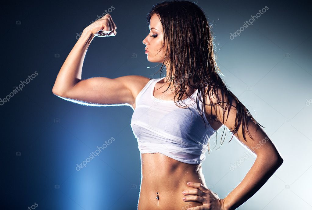 Young strong sexy woman showing her muscles. — Stock Photo #3071875