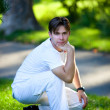Young man in park — Stock Photo