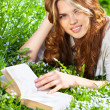 Young woman reading book — Foto de Stock