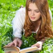 Young woman reading book — Foto de stock #3728237