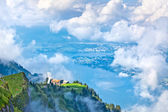 Swiss landscape through clouds — Stock Photo