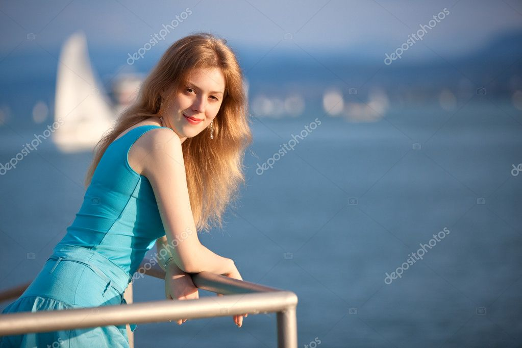 Young woman standing the shore portrait.  Stock Photo #3728032