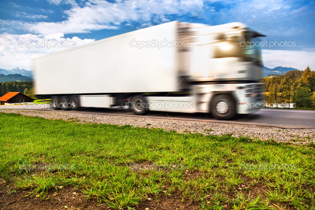 Truck transportation. Wide angle view and blurred motion effect. — Stock Photo #3728161