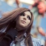Young schoolgirl in amusement park — Stock Photo #3738895