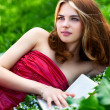 Stock Photo: Young woman with book