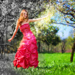 Young fairy woman in red dress - Stok fotoğraf