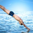 Swimmer jumping — Stock Photo