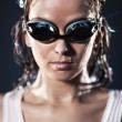 Foto Stock: Young woman swimmer portrait
