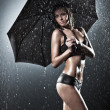Young sexy woman with umbrella — Stock Photo