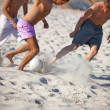 Young men playing soccer — Stock Photo