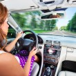 Young woman driving car - Stock Photo