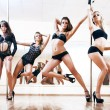 Four young sexy pole dance women — 图库照片