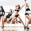 Four young sexy pole dance women — Lizenzfreies Foto