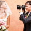 Husband taking picture of his wife — Foto de Stock