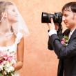 Husband taking picture of his wife — Stockfoto
