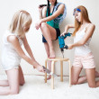 Young women repairing stool — Stock Photo