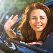 Young woman waving hand — Stock Photo