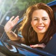 Young woman waving hand — Stock Photo #3739841
