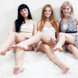 Three women showing their beauty legs — Stock Photo