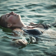 Stock Photo: Young woman swimming