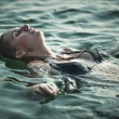 Young woman swimming — Foto de stock #3739870