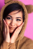 Young japan woman in bear suit — Stock Photo