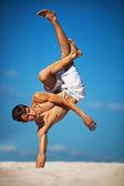Young man dancing — Stock Photo