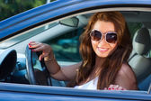 Woman in car portrait — Stock Photo