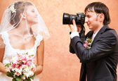 Husband taking picture of his wife — Stock Photo