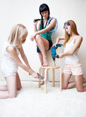 Young women repairing stool — ストック写真