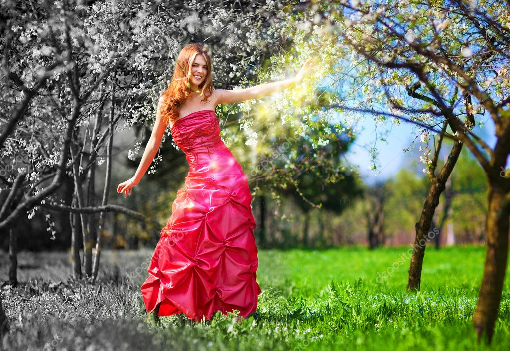 Young fairy woman in red dress painting garden. — Stock Photo #3738992