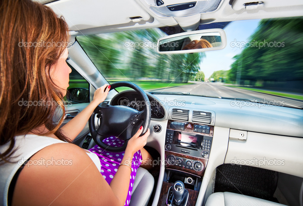 Young woman driving car. Fast motion effect.  Stock Photo #3739811