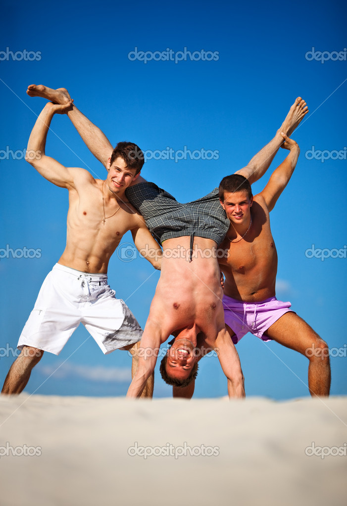 Three men summer vacation on beach.  Stock Photo #3739827