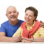 Happy senior couple against white background — Stock Photo