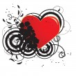 Red heart in a black flower ornament - Stock Vector