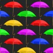Seamless a background with umbrellas — Stock Vector