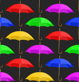 Seamless a background with umbrellas — Vector de stock